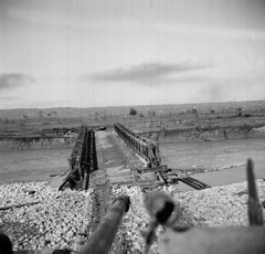 A Sqn tank crossing the Sangro over the Bailey bridge under fire
